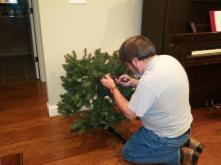 John rewiring Christmas tree lights after Ruby chewed the old ones.